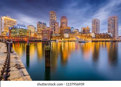 Boston, Massachusetts, USA downtown on the harbor at twilight.