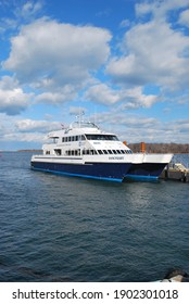 Boston, Massachusetts, USA - January 11, 2021: Several ferries were operating between Charles Town and Boston Long Wharf Pier.