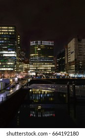 Boston, Massachusetts, USA - January 26, 2017: Lights along Harborwalk reflecting off water on Boston waterfront