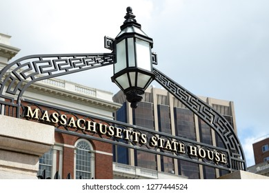 Boston, Massachusetts / USA - July 24 2018: Close up on the wrought iron sign and gates at the entrance to the Massachusetts State House