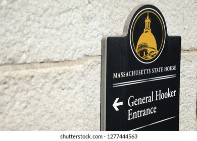 Boston, Massachusetts / USA - July 24 2018:  Close up on an exterior sign on the Massachusetts State House, pointing to the General Hooker Guest Entrance, with space for text on the left