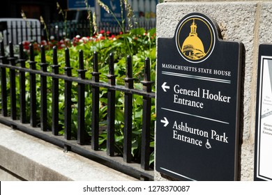 Boston, Massachusetts / USA - July 24 2018:  Exterior sign on the Massachusetts State House, pointing to the General Hooker Guest Entrance, with space for text on the left