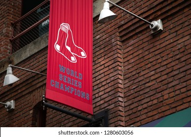 Boston, Massachusetts / USA - July 25 2018: Red Sox World Series Champions banner on the brick facade of Fenway Park, with space for text on the right