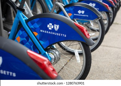 Boston, Massachusetts/ USA - July 26 2018: Side view on a row of Blue Bikes, a dock based bicycle sharing network, with Blue Cross sponsor logos on the fender