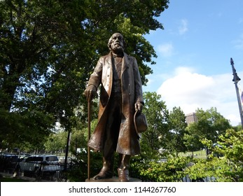 Boston, Massachusetts / USA - July 28 2018: Bronze and granite sculpture of writer and Unitarian minister Edward Everett Hale at Boston Public Garden near Charles Street