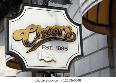 """Boston, Massachusetts / USA - July 28 2018: Close up on the """"Cheers Est. 1895"""" sign at the entrance to the nostalgic sitcom bar in downtown Boston"""