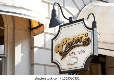"""Boston, Massachusetts / USA - July 28 2018: """"Cheers Est. 1895"""" sign at the entrance to the nostalgic sitcom bar in downtown Boston, with space for text on the left"""