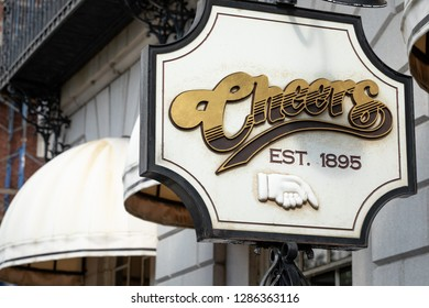 """Boston, Massachusetts / USA - July 28 2018: Close up on the """"Cheers Est. 1895"""" sign at the entrance to the nostalgic sitcom bar in downtown Boston, with space for text on the left"""