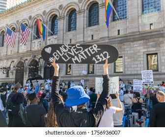 Boston, Massachusetts (USA)- June 14, 2020. The Association of the Pakistanis Physician met at the Boston Public Library to request justice for George Floyd. Protester raising skateboard with sign