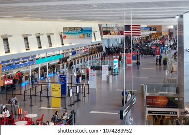 BOSTON MASSACHUSETTS USA - MARCH 27TH 2018; Interior of the departure hall in Logan International airport