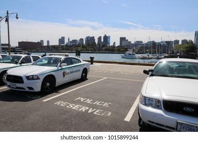 Boston, Massachusetts, USA - September 1 2017: US Park Rangers parked and in the background Boston Skyline