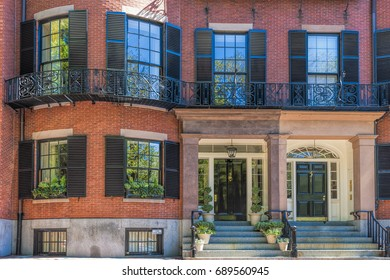 Boston, Massachusetts, USA - September 12, 2016: An attractive entrance to this lovely Federal architectural style building of brick on Beacon Hill in Boston, Massachusetts.