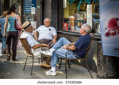 Boston, Massachusetts, USA - September 3, 2005 : Italian seniors meeting  in sidewalk of Boston, Massachusetts