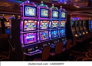 Boston, Massachusetts/USA - June 14 2019: a row of slot machines in the casino of the cruise ship Norwegian Gem await their users.