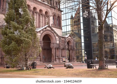 Boston, MA/USA 1-9-19: Tortoise and Hare statues by sculptor Nancy Schon, created as a 'meaningful metaphor' for the Boston Marathon. In front of Trinity Church, near the Boston Marathon finish line.
