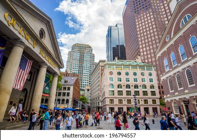 BOSTON - May 20: People visit famous Quincy Market on May 20, 2014 in Boston. Quincy Market dates back to 1825 and is a major tourism destination in Boston.