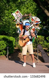 BOSTON - MAY 27: One-man band musician plays in Public Gardens on May 27, 2012 in Boston, MA