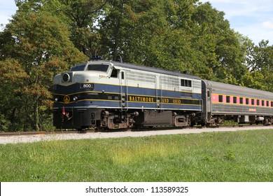 BOSTON MILLS, OHIO - SEPT. 15: Baltimore & Ohio diesel locomotive pulling the Cuyahoga Valley Scenic Railroad passenger train, heading north, on Sept. 15, 2012 near Boston Mills, Ohio