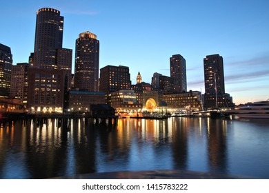 Boston night skyline - evening Waterfront view of the city.