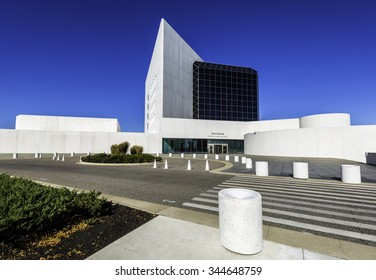 BOSTON - NOVEMBER 10: The modern architecture of The JFK Library and Museum in Boston, Massachusetts, USA with Boston Downtown on the background on November 10, 2015.