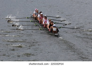 BOSTON - OCTOBER 19, 2014: Brown Alumni team races in the Head of Charles Regatta Men's Championship Eights, Craftsbury Sculling Center won with a time of 14:20