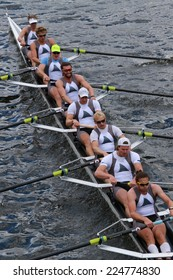BOSTON - OCTOBER 19, 2014: Taurus Boat Club races in the Head of Charles Regatta Men's Championship Eights, Craftsbury Sculling Center won with a time of 14:20