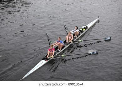 BOSTON - OCTOBER 23: Riverside Boat Club womens Fours races in the Head of Charles Regatta. Vesper Boat Club won with a time of 18:21 on October 23, 2011 in Boston, MA.