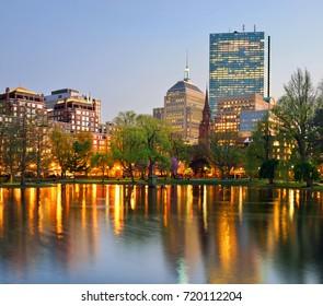 Boston Public Garden and city skyline at night