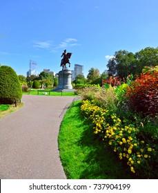 Boston Public Garden. Washington statue, colorful grounds, city skyline