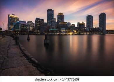 Boston skyline at dusk from Fan Pier Park