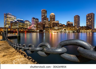 Boston skyline at dusk as viewed from Fan Pier Park.