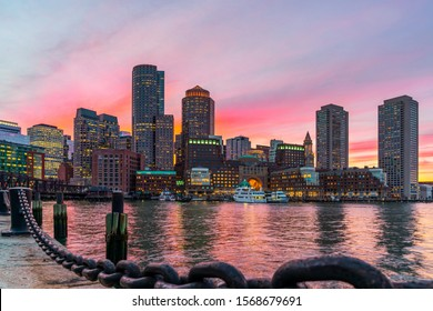 Boston skyline and Fort Point Channel at sunset as viewed fantastic twilight or dusk time from Fan Pier Park in Boston, Massachusetts, USA. United state downtown beautiful colorful skyline.