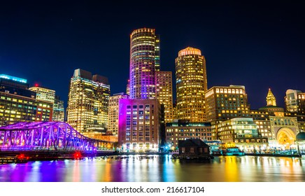 The Boston skyline and Fort Point Channel at night from Fan Pier Park, Boston, Massachusetts.