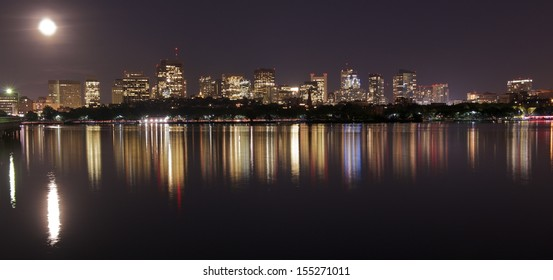Boston skyline at Full Moon from Harvard University Sailing Center, Boston, MA, USA