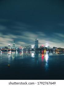 boston skyline at night from canmbridge