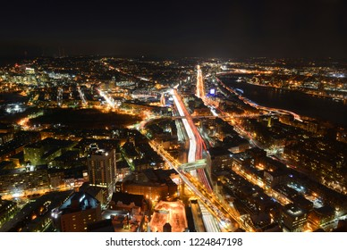 Boston Skyline at night, including Fenway Park and Interstate Highway I-90 (Massachusetts Turnpike), from top of Prudential Center toward west, Boston, Massachusetts, USA