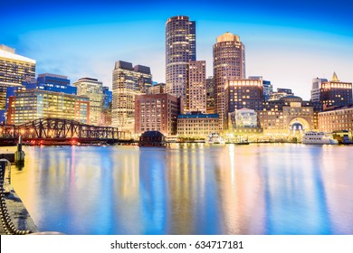 The Boston skyline at night, located in Fan Pier Park, Boston, Massachusetts, USA.