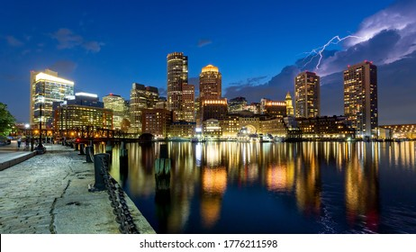 Boston skyline on the waterfront with lightning in the sky
