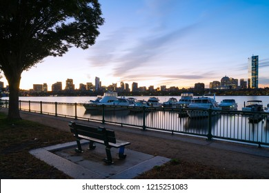 Boston skyline at sunrise with boats and harbor
