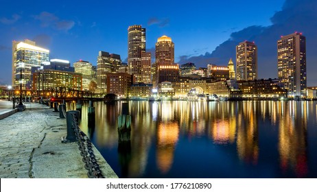 Boston skyline at the waterfront with city walk at dusk