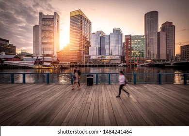 Boston at sunset showcasing its mix of contemporary and historic architecture at Boston Harbor and Financial District.