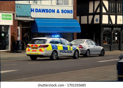 BOSTON UK, April 01, 2020: Police car pulling over a driver during the coronavirus lockdown