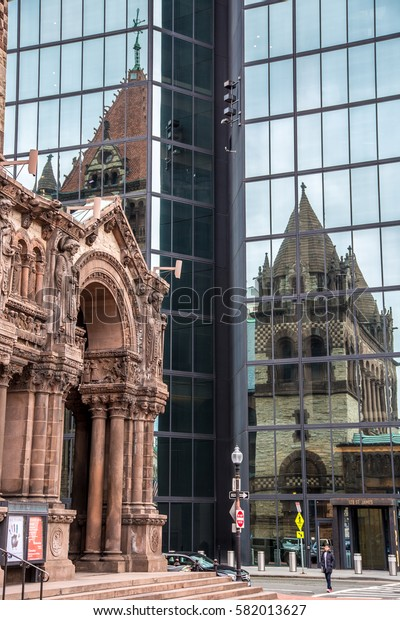 BOSTON, UNITED STATES - NOVEMBER, 2016: Trinity Church reflected in a tall glass building in Boston, USA.