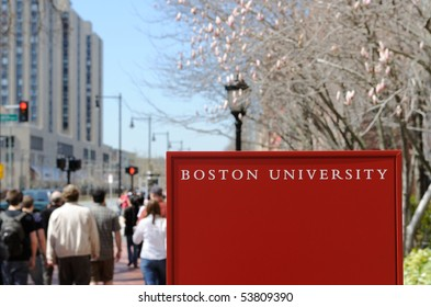 Boston University sign and crowd of students walking by in early spring