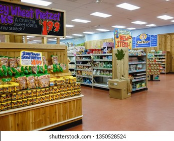 Boston, USA - 09 21 2012: Shelves with products and ailes with special offers and new food items inside Trader Joe's grocery store, a American supermarket chain owned by German discount retailer Aldi