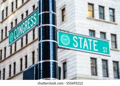 Boston, USA - 11 October, 2016:  street names hanging on column.