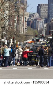 BOSTON, USA - APRIL 15: Boylston st in Boston, MA is still closed for the public who pass by leaving mementos while FBI conducts investigations on the Boston Marathon 2013 bombing on April 21, 2013.