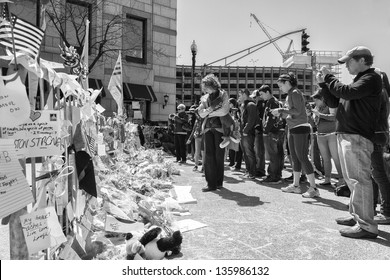 BOSTON, USA - APRIL 15: Locals and tourists pay respect and leave mementos at the Boylston Street improvised memorials in Boston, Massachusetts, USA on April 21, 2013.