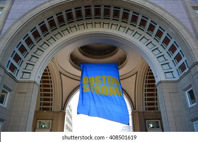 """Boston, USA - April 16, 2016: """"Boston Strong"""" banner hanging from Rowes Wharf marking the Patriots Day holiday and Boston Marathon in 2016 in Boston."""