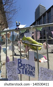 BOSTON, USA - APRIL 21: Locals and tourists left a lot of mementos and messages of courage at the several improvised memorials of the 2013 Boston Marathon bombing at Boylston st on April 21, 2013.